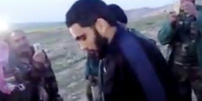 This Image Made From Video Posted On Twitter By A Kurdish Fighter Shows A Man That The Kurdish Military Says Is An American Member Of The Islamic State Group Shortly After He Turned Himself In To Kurdish Fighters In Northern Iraq, Monday, March 14, 2016. The Circumstances Of The Surrender Were Not Fully Disclosed But It Marked A Rare Instance In Which An IS Fighter Voluntarily Gave Himself Up To Iraqi Or Kurdish Forces In Iraq. (Kurdish Fighter Via AP)